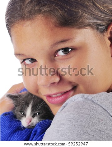 stock photo : Closeup portrait of a young teen snuggling with her tiny gray ...