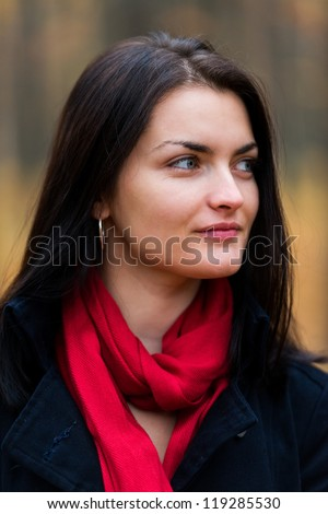 Closeup portrait of a young woman in the forest