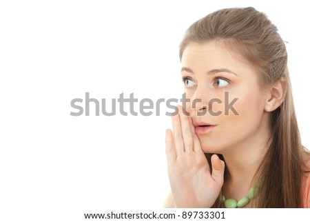 Closeup portrait of a young woman whispering gossips against white background - Copyspace