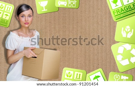 Closeup portrait of a young woman with boxes moving to her new home. Carrier service concept