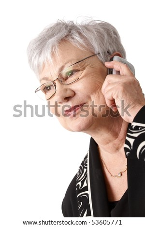 Closeup portrait of active older woman using mobile phone, isolated on white.