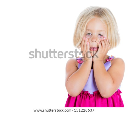 Closeup portrait of adorable, but sad and stressed girl pulling eyes down with fingers, isolated on white background with copy space to left