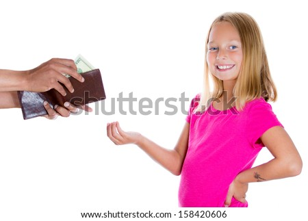 Closeup portrait of adorable girl smiling and demanding money for allowance, guy pulls out money from wallet to give her, isolated on white background