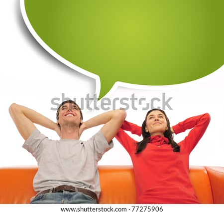 Closeup portrait of adult couple sitting on their sofa at their apartment and dreaming about something. Blank balloon at the top of the photo for your text. Planning future concept