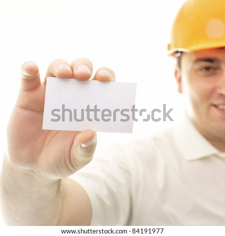 Closeup portrait of adult engineer man holding blank business card