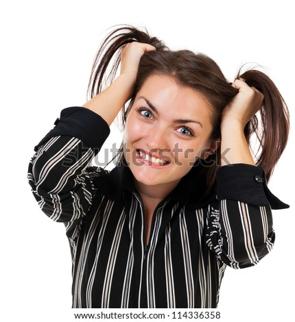 Closeup portrait of an angry businesswoman pulling her hair, isolated on white background