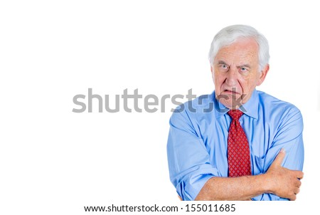 Closeup portrait of an angry, mad, annoyed senior businessman, corporate employee, retired man, isolated on white background with copy space. Human emotions and interpersonal conflict resolution.