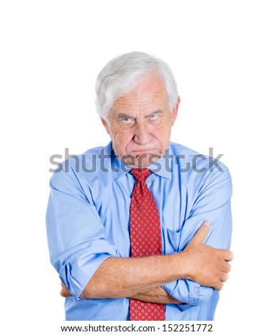 Closeup portrait of an angry mad annoyed senior businessman isolated on white background Human emotions and interpersonal conflict resolution