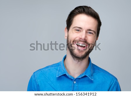 Closeup portrait of an attractive caucasian man laughing