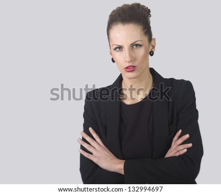 Closeup portrait of an attractive pensive businesswoman isolated on white background