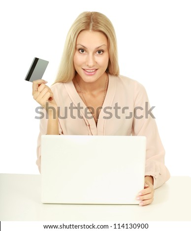 Closeup portrait of an attractive young woman with a laptop sitting at the desk - stock photo