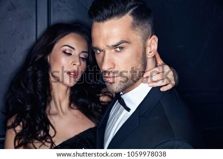Closeup portrait of an elegant, stylish, young couple #1059978038