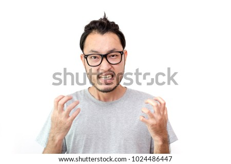 Closeup portrait of angry asian man screaming, isolated on white background with copy space #1024486447