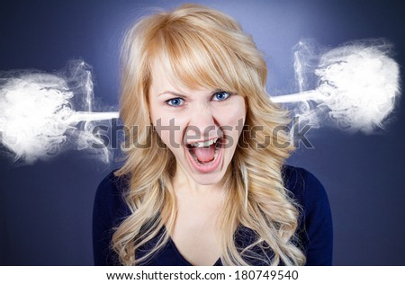 Closeup portrait of angry pissed off upset mad business woman student screaming steam going out from ears isolated on blue black background Negative human face expressions emotions reaction
