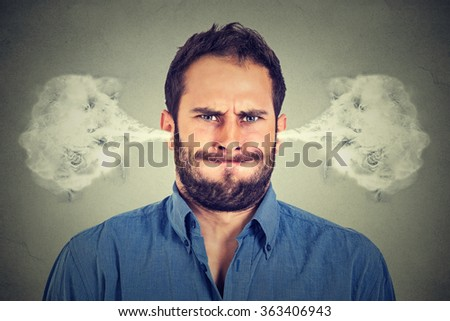 Closeup portrait of angry young man, blowing steam coming out of ears, about to have nervous atomic breakdown isolated gray background. Negative human emotions facial expression feelings attitude #363406943