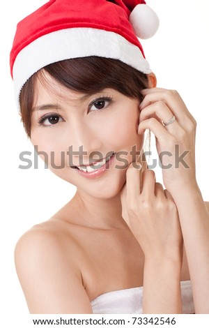 Closeup portrait of Asian Christmas lady smiling and looking at you on white background.