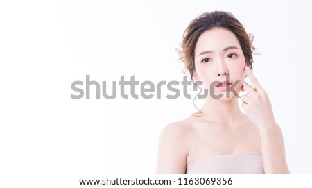 Closeup portrait of asian woman with fair perfect healthy glow skin isolated on white background, asian beautiful girl with pretty smile on her face. Beauty clinic skincare spa and surgery concept
