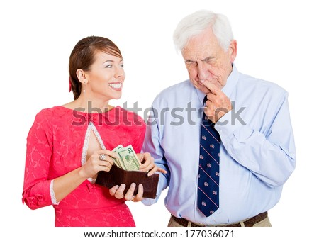 Closeup portrait of attractive happy woman asking for money from pensive senior mature, old man hesitant to dole out dollars to her from brown wallet, isolated on white background. Negative emotions