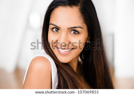 Closeup portrait of attractive indian young woman smiling cute