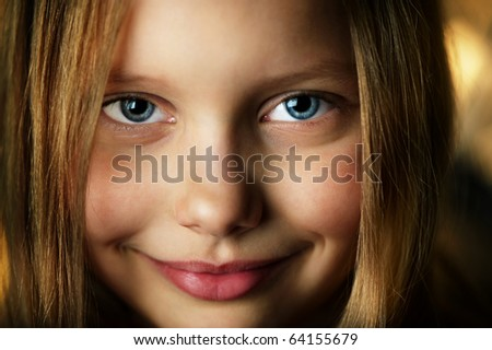 Closeup portrait of attractive smiling little girl. Shallow DOF