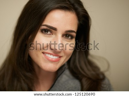 Closeup portrait of attractive smiling young woman