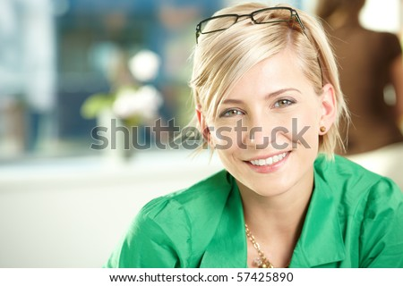 Closeup portrait of attractive young businesswoman wearing green shirt, smiling. #57425890