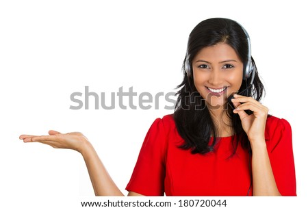 Closeup portrait of beautiful, adorable smiling female customer representative with phone headset pointing at copy space isolated on white background. Positive human emotions, facial expressions #180720044