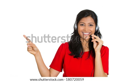 Closeup portrait of beautiful, adorable smiling female customer representative with phone headset pointing at copy space isolated on white background. Positive human emotions, facial expressions #180720059