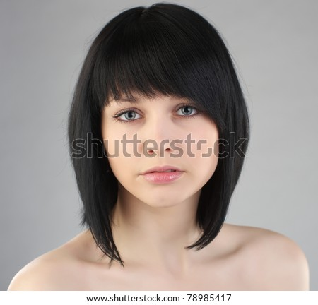 Closeup portrait of beautiful brunette woman with fashion hairstyle