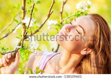 Closeup portrait of beautiful calm woman enjoying spring nature with closed eyes, having fun outdoors, pleasure concept