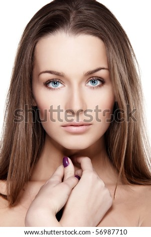 Closeup portrait of beautiful female model with blue eyes on white background