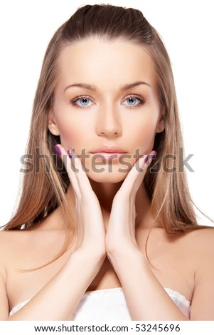Closeup portrait of beautiful female model with blue eyes touching her face on white background