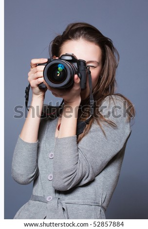 Closeup portrait of beautiful female photographer shooting