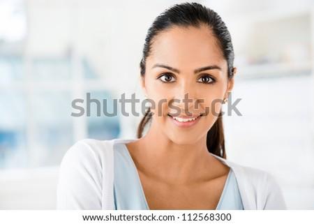 Closeup portrait of beautiful Indian woman smiling at camera