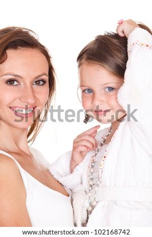 Closeup portrait of beautiful mother and preschool daughter