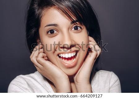 Young Girl Looking At The Camera Long Dark Hair And Brown