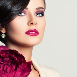 Closeup Portrait of Beautiful Woman Fashion Model with Makeup and Peony Flower. Cute Face