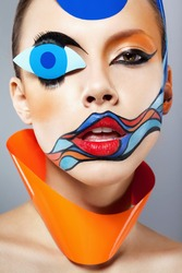 Closeup portrait of beautiful woman with painted art makeup and carnival decoration. Natural beauty, clean fresh skin. Looking at camera. Inside