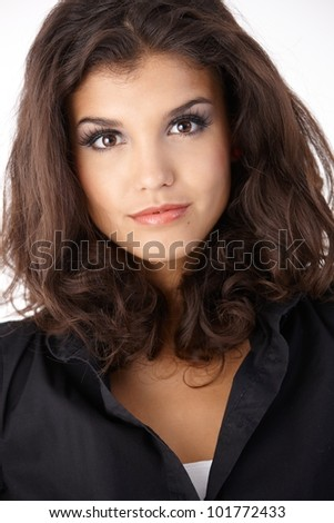 Closeup portrait of beautiful young woman looking at camera.