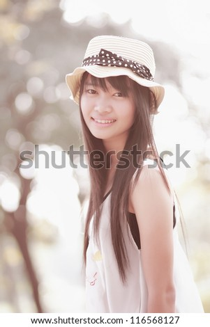 Closeup portrait of beautiful young woman smiling - Outdoor