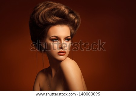 Closeup Portrait Of Beautiful Young Woman With Creative Makeup And Hairstyle Against Brown Background