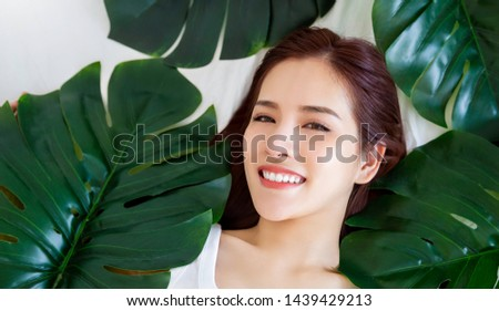 Closeup portrait of beauty asian woman spa green leaf, asia face perfect healthy glow skin, asian beautiful girl. Beauty clinic skincare organic natural spring earth day environment concept banner