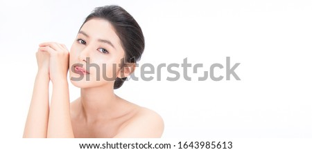 Closeup portrait of beauty asian woman with fair perfect healthy glow skin hand touch shoulder copy space, young beautiful asia girl with pretty smile on face. Beauty korean clinic skincare banner