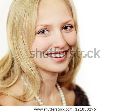 Closeup portrait of blonde woman with pearls
