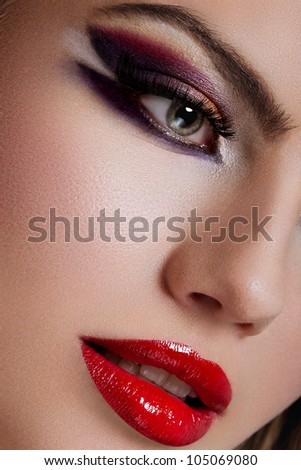 closeup portrait of blonde young woman, with green eyes, full lips and fashion makeup - high end retouching