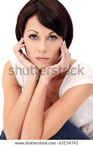Closeup portrait of brunette female model with blue eyes on white background
