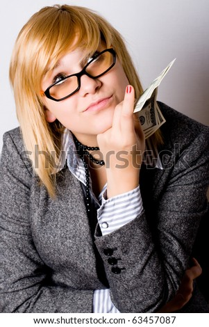closeup portrait of businesswoman with money