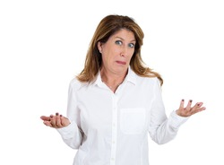 Closeup portrait of clueless, puzzled woman with arms out asking what's the problem, who cares, so what, I don't know, isolated on white background. Negative human emotion, facial expression, attitude