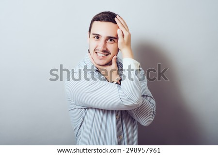 Closeup portrait of crazy man  twisting arms around head in wacky ways