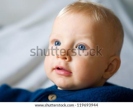 Closeup portrait of cute baby boy